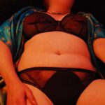 lying back in bra and panties